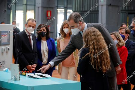 Spain's King Felipe VI (4L) looks at a device next to President of Cotec Foundation, Cristina Garmendia (3L); Science and Innovation Minister, Pedro Duque (L), as he attends the launching of 2021 Annual Report by COTEC Foundation in Madrid, Spain, 26 May 2021. The report compiles analysis and data of the evolution of Research Development and Innovation (R+D+I) in Spain and offers proposals to make the innovation will be the economic and social growth driver in the country.