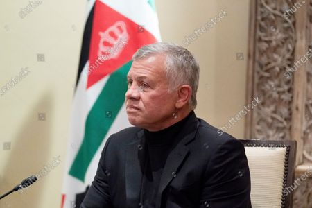 Jordan's King Abdullah II listens during a meeting with Secretary of State Antony Blinken at Bayt Al Urdon, in Amman, Jordan