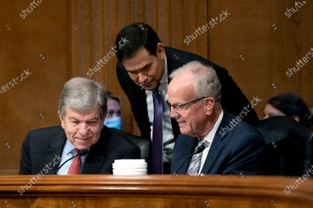 Sen. Roy Blunt, R-Mo., from left, Senator Marco Rubio, R-Fla., and Sen. Jerry Moran, R-Kan., huddle during a Senate Appropriations Subcommittee looking into the budget estimates for National Institute of Health (NIH) and the state of medical research, on Capitol Hill in Washington