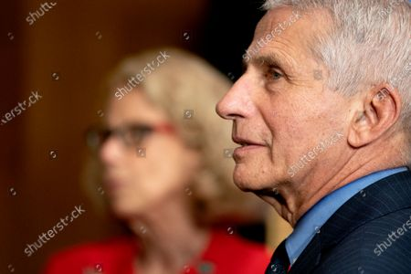Anthony Fauci, director of the National Institute of Allergy and Infectious Diseases, right, and Diana Bianchi, director of the Eunice Kennedy Shriver National Institute of Child Health and Human Development, speak following a Senate Appropriations Subcommittee hearing in Washington, DC, USA, 26 May 2021. The hearing is titled 'National Institutes of Health's FY22 Budget and the State of Medical Research.'