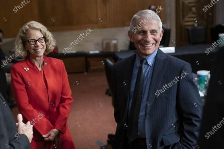 Dr. Diana Bianchi, director of the Eunice Kennedy Shriver National Institute of Child Health and Human Development, left, and Dr. Anthony Fauci, director of the National Institute of Allergy and Infectious Diseases talk after a Senate Appropriations Labor, Health and Human Services Subcommittee hearing on Capitol Hill in Washington, DC, USA, 26 May 2021.