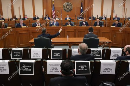 Stock Photo of Curtis Morgan, the CEO of Vistra Corp., at table left, testifies as the Committees on State Affairs and Energy Resources holds a joint public hearing to consider the factors that led to statewide electrical blackouts, in Austin, Texas. Only days remain for Texas lawmakers to make good on promised overhauls following one of the largest power outages in U.S. history, when more than 4 million customers lost heat after an artic blast buckled the state's electric grid