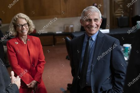 Dr. Diana Bianchi, director of the Eunice Kennedy Shriver National Institute of Child Health and Human Development, left, and Dr. Anthony Fauci, director of the National Institute of Allergy and Infectious Diseases talk after a Senate Appropriations Labor, Health and Human Services Subcommittee hearing on Capitol Hill in Washington, DC.