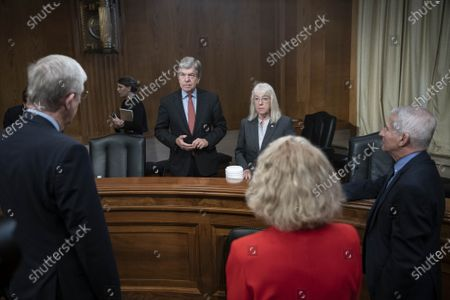 Senate Appropriations Labor, Health and Human Services Subcommittee Chair Senator Patty Murray and ranking member Senator Roy Blunt (R-MO) speak with NIH Director Dr. Francis Collins, Dr. Diana Bianchi, director of the Eunice Kennedy Shriver National Institute of Child Health and Human Development, and Dr. Anthony Fauci, director of the National Institute of Allergy and Infectious Diseases, before a subcommittee hearing on Capitol Hill i