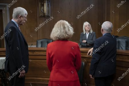 Senate Appropriations Labor, Health and Human Services Subcommittee Chair Senator Patty Murray speaks with NIH Director Dr. Francis Collins, Dr. Diana Bianchi, director of the Eunice Kennedy Shriver National Institute of Child Health and Human Development, and Dr. Anthony Fauci, director of the National Institute of Allergy and Infectious Diseases, before a subcommittee hearing on Capitol Hill i