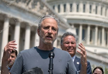 Entertainer and activist Jon Stewart lends his support to House Veterans Affairs Committee Chair Mark Takano, D-Calif., right, as lawmakers work on legislation to expand benefits and improve care for military veterans suffering from toxic exposure to burn pits and other hazards, at the Capitol in Washington