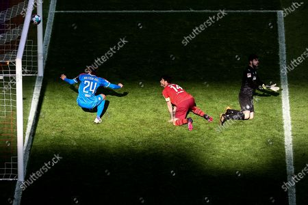 Stock Photo of Cologne's Jonas Hector (C) in action against Kiel's goalkeeper Ioannis Gelios (R) and Hauke Wahl (L) during the German Bundesliga relegation play-off, first leg soccer match between 1. FC Koeln and Holstein Kiel in Cologne, Germany, 26 May 2021.