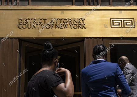People enter a courthouse building past a sign for the District Attorney of the County of New York in New York, New York, USA, 26 May 2021. It was revealed on 25 May that Manhattan District Attorney Cyrus R. Vance Jr. has reportedly convened a grand jury to hear evidence collected as a result of a two-year long investigation by Vance's office into potential criminal acts by former US President Donald Trump, the Trump Organization, and executives at the company.