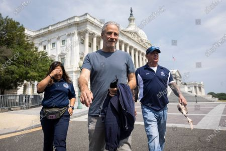 Comedian Jon Stewart (C) prepares to join Veterans Affairs Committee Chairman Mark Takano (not pictured) to unveil legislation addressing toxic exposure among veterans outside the US Capitol in Washington, DC, USA, 26 May 2021.