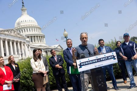 Comedian Jon Stewart (C-R) joins Veterans Affairs Committee Chairman Mark Takano (C-L) to unveil legislation addressing toxic exposure among veterans outside the US Capitol in Washington, DC, USA, 26 May 2021.