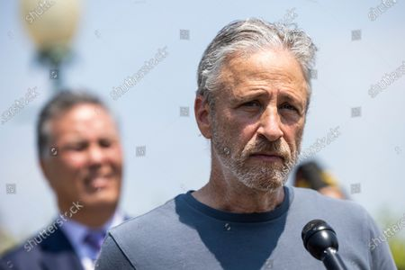 Stock Photo of Comedian Jon Stewart (R) joins Veterans Affairs Committee Chairman Mark Takano (L) to unveil legislation addressing toxic exposure among veterans outside the US Capitol in Washington, DC, USA, 26 May 2021.