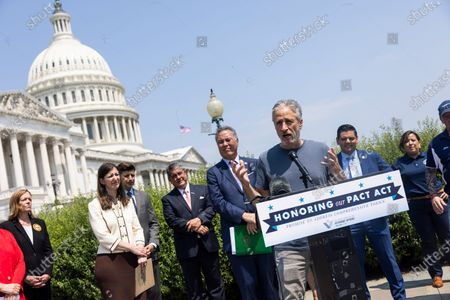 Stock Image of Comedian Jon Stewart (C-R) joins Veterans Affairs Committee Chairman Mark Takano (C-L) to unveil legislation addressing toxic exposure among veterans outside the US Capitol in Washington, DC, USA, 26 May 2021.