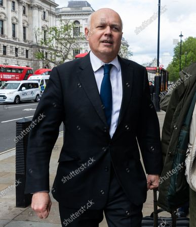 Stock Photo of Former Conservative leader Iain Duncan Smith MP seen outside the Houses of Parliament, London, England on  Wednesday 26th May 2021.