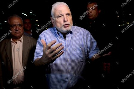 Panama's former President Ricardo Martinelli talks to reporters near his home, in Panama City. Martinelli and former President Juan Carlos Varela are on the list of 50 people that an anti-corruption prosecutor's office asks to be called to trial in the bribery case of involving the Brazilian construction company Odebrecht, said prosecutor Tania Sterling, on