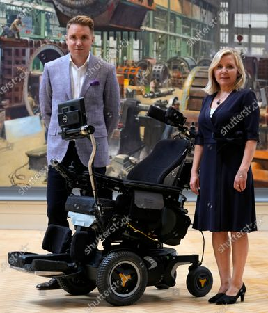 Lucy and Tim Hawking stand with the whelchair used by their late father Professor Stephen Hawking which has been acquired by the Science Museum Group, in London, . Science Museum Group and Cambridge University Library will announce that they have acquired the historic contents of Professor Stephen Hawking's office (going to SMG) and his archive (going to CUL