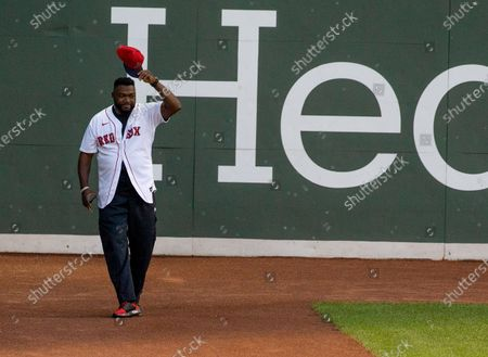 Former Boston Red Sox player David Ortiz tips his hat to the crowd after exiting the Green Monster between the first and second inning of the MLB baseball game between the Boston Red Sox and Atlanta Braves at Fenway Park in Boston, Massachusetts, USA, 26 May 2021.