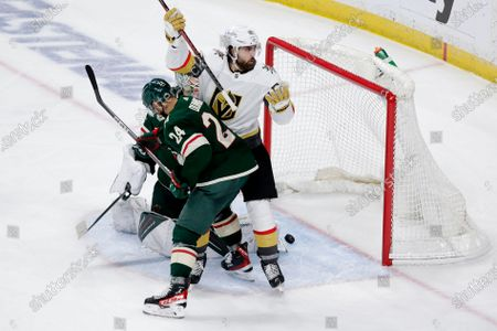 Stock Picture of Vegas Golden Knights right wing Alex Tuch (89) is called for goalie interference on an apparent goal by Golden Knights center Chandler Stephenson, not seen, with Minnesota Wild defenseman Matt Dumba (24) in the crease in front of Wild goaltender Cam Talbot (33) during the third period in Game 6 of an NHL hockey Stanley Cup first-round playoff series, in St. Paul, Minn. The Wild won 3-0