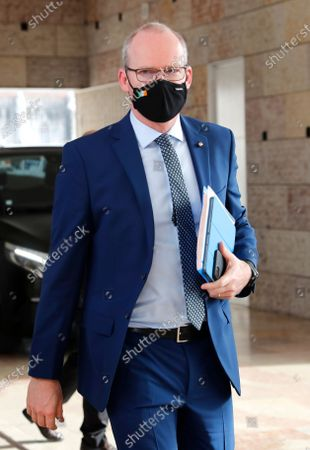 Ireland's Foreign Minister Simon Coveney arrives for a meeting of EU foreign ministers in Lisbon, . European Union foreign ministers meet Thursday to discuss EU-Africa relations and Belarus