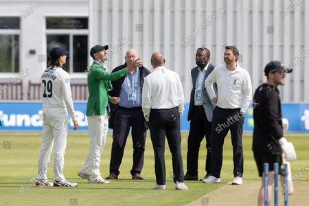 Colin Ackemann (green jacket) flips the coin as Peter Handscomb calls during Day 1 of the LV= Insurance County Championship match between Leicestershire County Cricket Club and Middlesex County Cricket Club at the Uptonsteel County Ground, Leicester