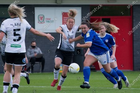 Stock Image of Catherine Walsh (19 Cardiff) and Tija Richardson (22 Swansea) battle for the ball during the Welsh Premier Womens Football League Cup Final game between Swansea City and Cardiff City at Dragon Park in Newport, Wales.