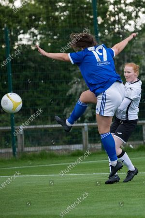 Stock Photo of Catherine Walsh (19 Cardiff) attempts to block the ball during the Welsh Premier Womens Football League Cup Final game between Swansea City and Cardiff City at Dragon Park in Newport, Wales.