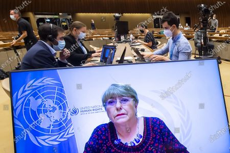 UN High Commissioner for Human Rights Michelle Bachelet, is seen on a screen delivering her speech during a special session of the UN Human Rights Council to discuss situation in the Occupied Palestinian Territory, at the European headquarters of the United Nations in Geneva, Switzerland, 27 May 2021.
