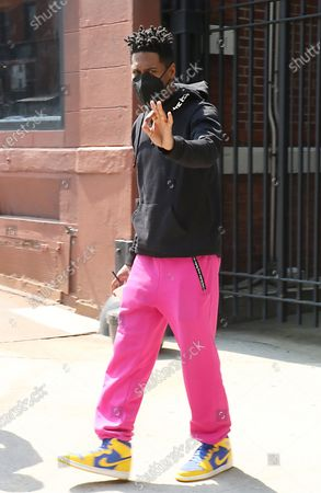 Stock Image of Jon Batiste exits CBS Studios after guest-hosting on CBS This Morning