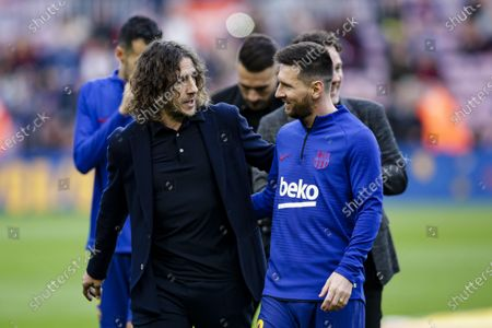 Carles Puyol and Lionel Messi during La Liga match between FC Barcelona and Deportivo Alaves at Camp Nou on December 21, 2019 in Barcelona, Spain.