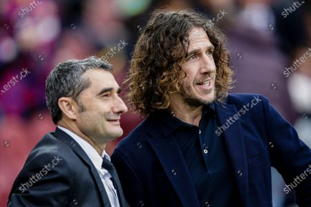 Ernesto Valverde from Spain and Carles Puyol of FC Barcelona during La Liga match between FC Barcelona and Deportivo Alaves at Camp Nou on December 21, 2019 in Barcelona, Spain.