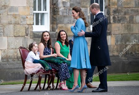 Mila Sneddon, 5, with her sister Jodi, and parents Lynda and Scott Sneddon, during the Beating of the Retreat, as special guests of Prince William and Catherine Duchess of Cambridge, at the Palace of Holyroodhouse in Edinburgh. Cancer patient Mila features in an image from the Hold Still photography project which showed her kissing her father Scott through a window whilst she was shielding during her chemotherapy treatment