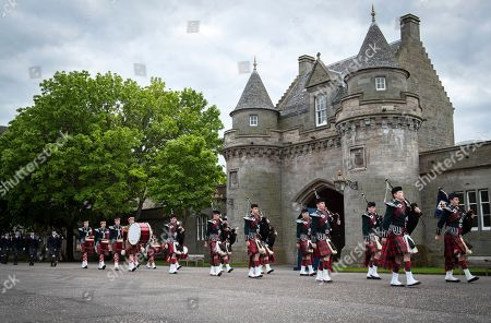 Massed pipes and drums at the Beating of the Retreat at the Palace of Holyroodhouse in Edinburgh