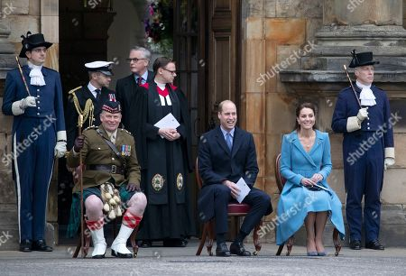 Prince William and Catherine Duchess of Cambridge sit with Lieutenant Colonel Craig Stewart (left), during a Beating of the Retreat at the Palace of Holyroodhouse in Edinburgh