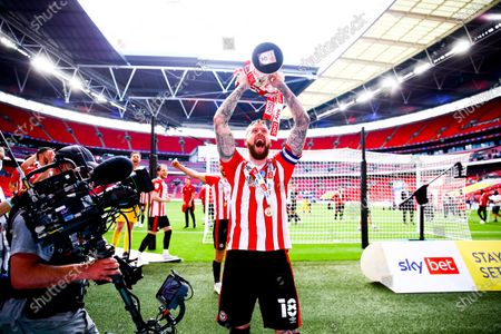 Pontus Jansson of Brentford  celebrates with the playoff trophy