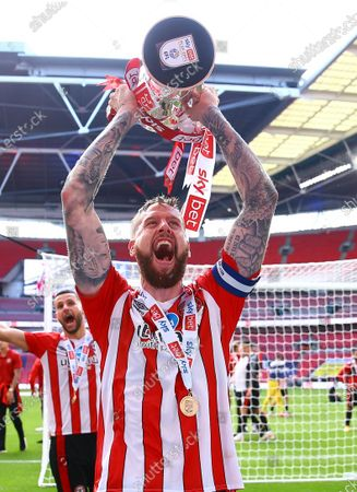 Pontus Jansson of Brentford lifts the Sky Bet Championship Play Off trophy