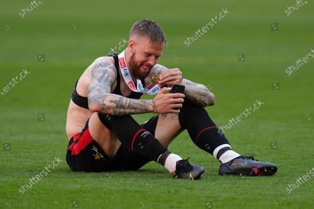 Pontus Jansson of Brentford celebrates with his winners medal
