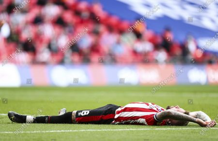 Stock Picture of Pontus Jansson of Brentford lays injured