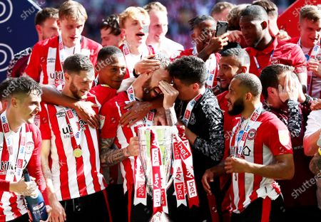 Stock Image of Pontus Jansson of Brentford wipes his eyes in the celebrations.