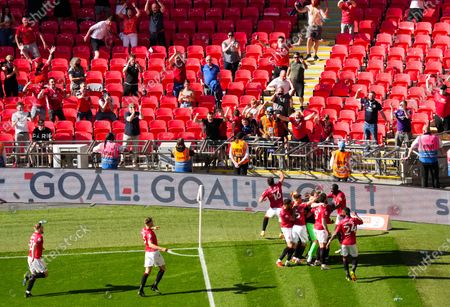Carlos Mendes Gomes of Morecambe scores from the penalty spot past Tom King of Newport County in extra time & celebrates in the corner