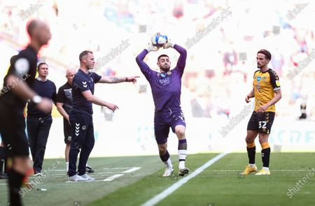 Tom King of Newport County takes a throw in