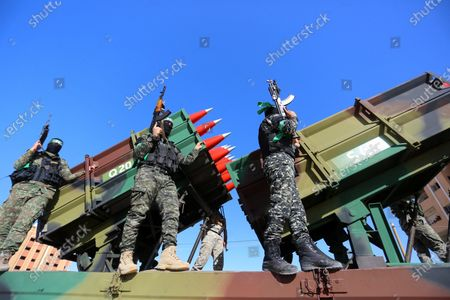 Members of the Izz-Al Din Al-Qassam Brigades, the armed wing of the Hamas movement, parade in an anti-Israel rally in Khan Younis, in the southern Gaza Strip on May 27, 2021. - The Egyptian-brokered truce ended 11 days of heavy Israeli bombing of Gaza and rocket fire from the impoverished coastal enclave into Israel. Israeli air strikes and artillery fire on Gaza killed 254 Palestinians, including 66 children, and wounded more than 1,900 people in 11 days of conflict from May 10, the health ministry in Gaza says. Rocket and other fire from Gaza claimed 12 lives in Israel, one Indian national and two Thai workers, medics say. Some 357 people in Israel were wounded.
