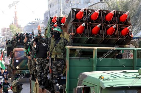 Editorial picture of Members of the Izz-Al Din Al-Qassam Brigades, the armed wing of the Hamas movement, parade in an anti-Israel rally in Khan Younis, Khan Younis, Gaza Strip, Palestinian Territory - 27 May 2021