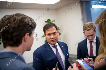 United States Senator Marco Rubio (Republican of Florida) talks to reporters as he waits for a train in the Senate subway, during a vote at the US Capitol in Washington, DC,.
