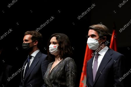 Stock Photo of (L-R) Spanish People's Party president Pablo Casado, Madrid's regional President Isabel Diaz Ayuso, and Spanish former prime minister and current President of the Foundation for Analysis and Social Studies (FAES), Jose Maria Aznar, pose for photographers before presenting Venezuelan opposition leader Juan Guaido (unseen) the X FAES Freedom Award via video conference, in Madrid, Spain, 27 May 2021.