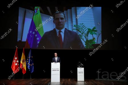 Stock Picture of Spanish former prime minister and current President of the Foundation for Analysis and Social Studies (FAES), Jose Maria Aznar, delivers a speech in front of a screen showing Venezuelan opposition leader Juan Guaido before presenting him the X FAES Freedom Award via video conference, in Madrid, Spain, 27 May 2021.