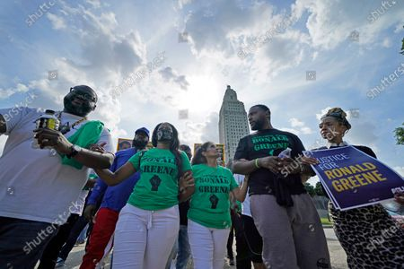 Mona Hardin, center, mother of Ronald Greene, participates in a march from the state Capitol to the governor's mansion in Baton Rouge, La., protesting the death of Greene, who died in the custody of Louisiana State Police in 2019