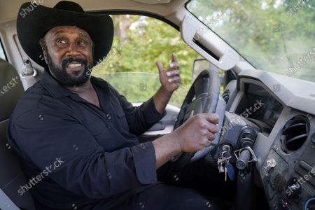 Stock Picture of Farmer John Boyd Jr., smiles as he drives his truck at his farm in Boydton, Va