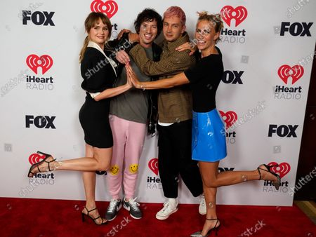Josh Dun, center right, and Tyler Joseph, center left, of Twenty One Pilots, pose with Debby Ryan, left, and Jenna Joseph, right, at the iHeartRadio Music Awards at the Dolby Theatre, in Los Angeles