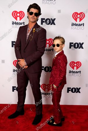 Robin Thicke and his son Julian attend the iHeartRadio Music Awards at the Dolby Theatre, in Los Angeles