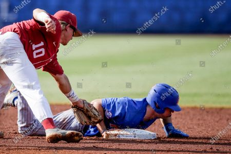 Stock Photo of Florida outfielder Jacob Young (1) dives back to second before the tag of Alabama infielder Jim Jarvis (10) in the third inning of an NCAA college baseball game during the Southeastern Conference tournament in Hoover, Ala