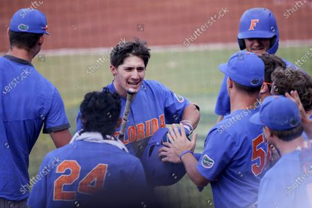 Stock Picture of Florida outfielder Jacob Young (1) celebrates with teammates after hitting a homer against Alabama in the sixth inning of an NCAA college baseball game during the Southeastern Conference tournament in Hoover, Ala